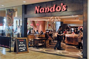 Despite 31 US locations, Nando's rejects imported chicken at its SA locations
